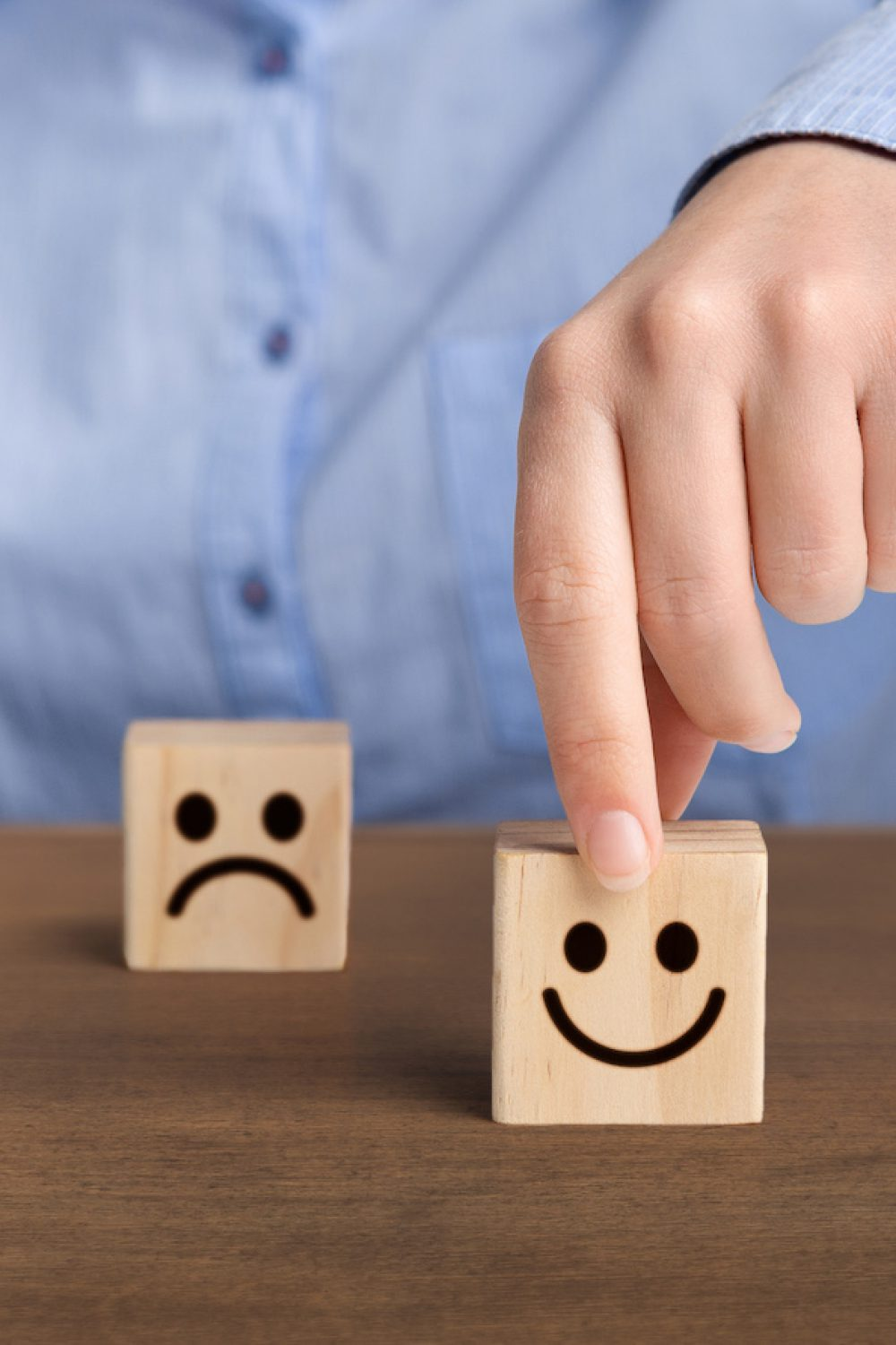 The best excellent business services rating. Hand of a businessman chooses a smiley face on wood block cube, panorama, copy space